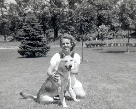 My mother and Sheba (our German Shepherd) in our front yard in Wisconsin.