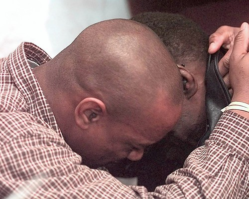 Walter Payton breaks down in tears near the end of his press conference after he announced that he has a rare liver disease that will require him to have a Liver transplant as his son Jarrett gives him a hug.  Photo James Prisching, Chicago Tribune F
