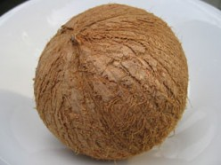 Macapuno nut/fruit with its shell.  It looks like the regular coconut.