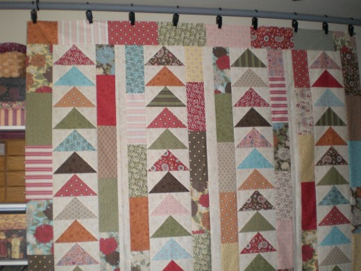 Open Season, quilt top. Quilt designed by Carrie Nelson, pieced by Judy Adams, and quilted by Diane Tricka.