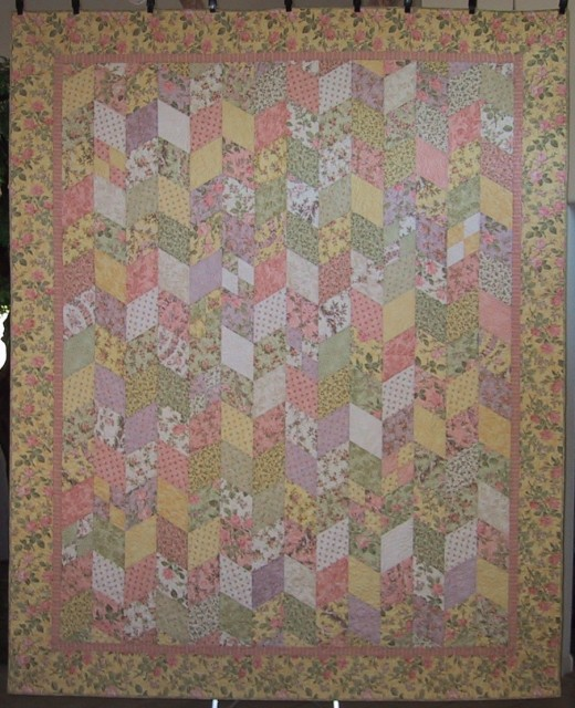 Sweet Emma Rose, quilt designed by Carrie Nelson, pieced by Judy Adams, and quilted by Sandra Strunk.