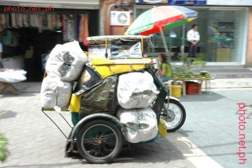 The tricycle is a motorcycle with a sidecar