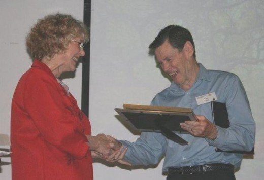 The writer receiving recognition for his prize winning story, The Longest Day, From ASCCA President, Nan Bosler, OAM in 2008.  Yes, and he was runner up (2nd Place) in 2007.