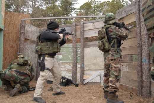 In this airsoft game, a team has to defend a bunker in the middle of a field. Airsoft projectiles cannot penetrate wood