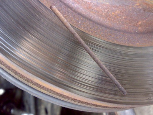The blue tinge in the metal is an indication of overheating. This disc needs machining or replacing, depending on it's remaining thickness after a cut.