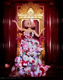 Lady Gaga between two pillars, sitting below a Masonic Compass.