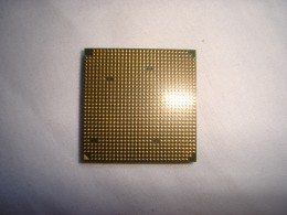 Bottom of a AMD 4200+ x2 processor. Notice all the little golden pins.