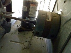 Another view of fan motor and compressor.