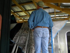 Ladders and padding help to prevent damage to the RV roof and exterior.