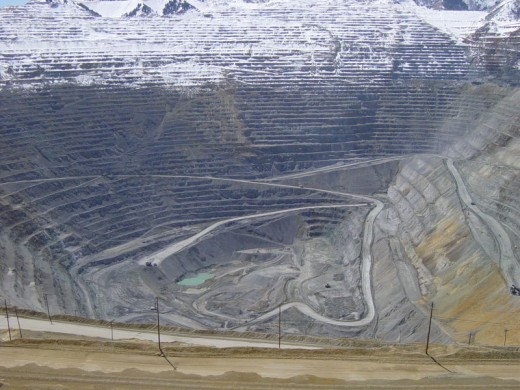 Many open pit mines are as large as impact craters and can be seen from space. Where does all that displaced waste go?