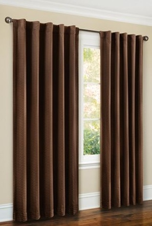 Brown curtains make a great neutral color that is calming and relaxing.