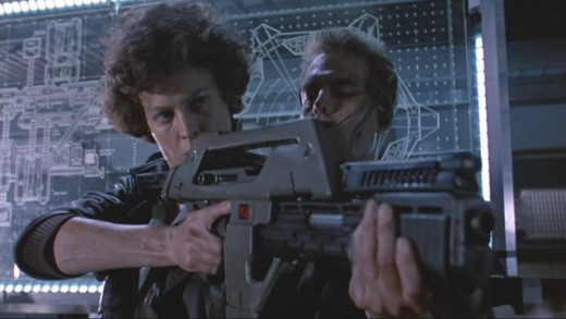 Ripley learning how to use the pulse rifle from Hicks in Aliens