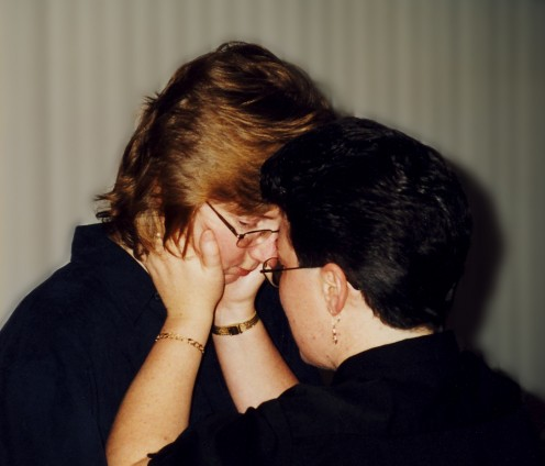 A quiet moment is captured at our ceremony.    copyright 1996