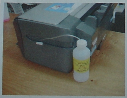 6:  Using the adhesive Velcro, attach the bottle to the printer.
