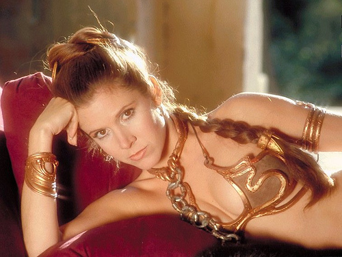 Famous photo of Carrie Fisher in her slave Princess Leia outfit