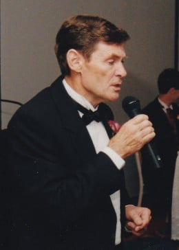 The writer in 1999 speaking at a formal gathering.