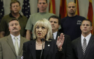 Apr. 23: Standing in front of law enforcement officers, Arizona Gov. Jan Brewer talks about signing the immigration bill in Phoenix.