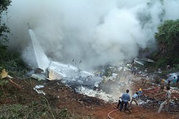 European Pressphoto Agency - Courtesy:- Firefighters try to put out the fire on the Air India plane. It overshot the runway while landing in the southern Indian city of Mangalore.