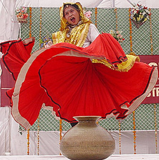 A lady dancing in her religion dance