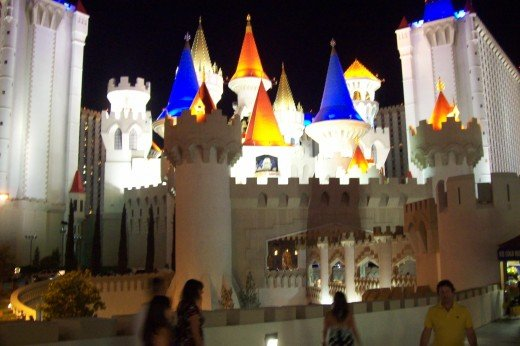 The Excalibur lit up at night