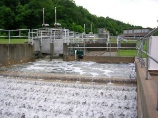 Water treatment plants cleanse industrial waste before spilling the treated water into the natural waterways.
