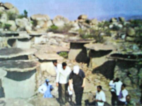 Tourists visiting the uninhabited village