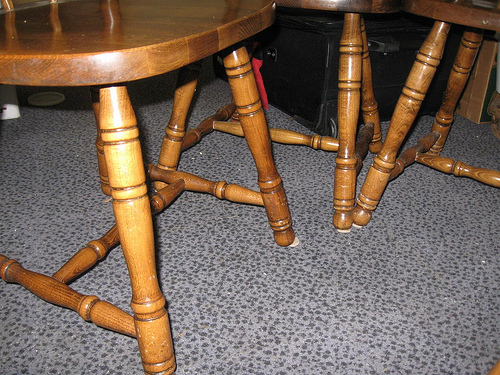 Picture of a few well designed wood chair legs.