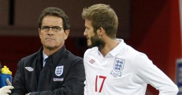Capello and Beckham. It looks like Beckham may have a coaching role for World Cup 2010