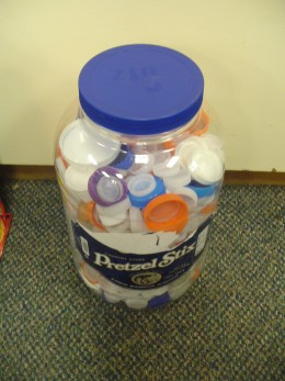 Students bring their bottle caps for recycling purposes