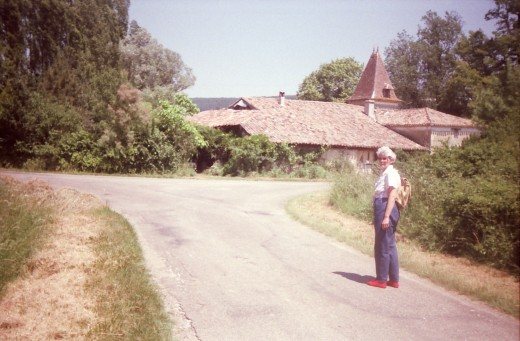 Joan in the road and the Moulin in the background