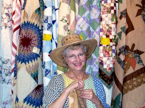 My mom at the Bean Palace gift shop, you can see all the quilts in the background.