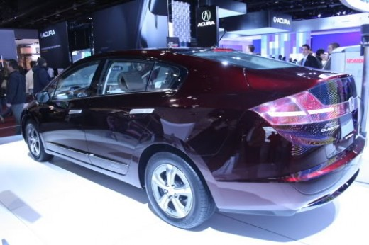 A rear quarter view shows some of the Honda Clarity's style.