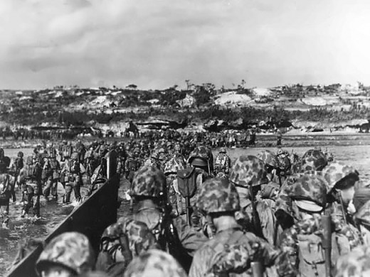 Marine reinforcements wading ashore at Okinawa