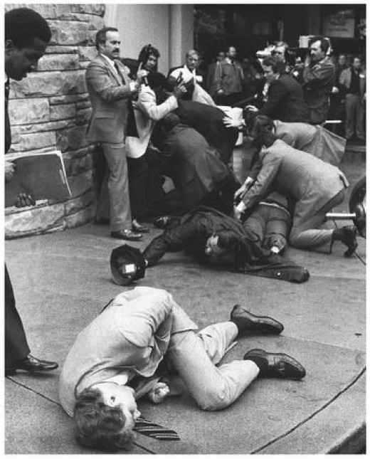 Timothy McCarthy in the foreground after shielding President Reagan with his body