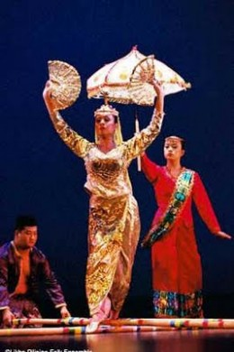 A Maranaw princess or lady of royalty with her maid dancing th Singkil.