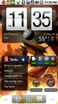 "ADWLauncher, with Fancy Widget (the clock), Astrid, and Dazzle. Note the Froyo (Android 2.2)-like static shortcuts and ""dockbar"", and the ""dots"" in lower/left right corner like Nexus One."