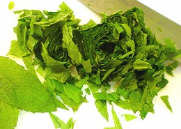 Mint leaves tightly rolled together and chopped