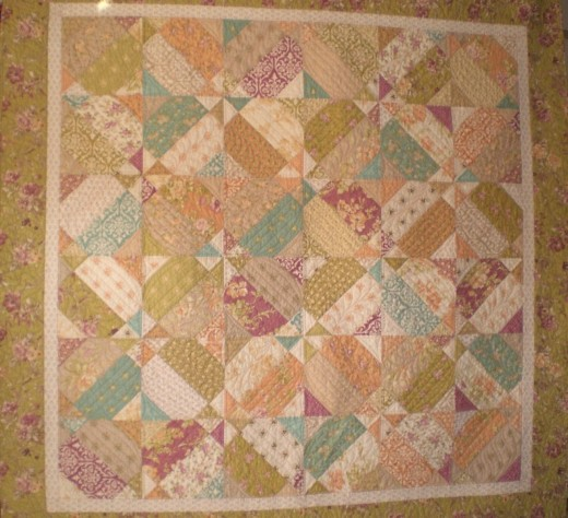 Little Red, quilt designed by Carrie Nelson, pieced by Judy Adams, and quilted by Diane Tricka.