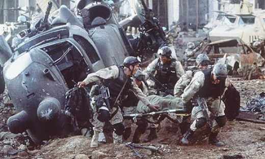 Delta Force evacuates wounded commrade to relative safety under fire.