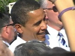 At an October '08 rally in Cincinnati, the guy right next to me got to shake Barack Obama's hand as he passed through the crowd. I was more interested in getting the picture.