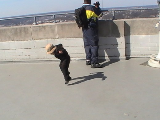 While Greg shot video from the top of Cincinnati's Carew Tower, Mom snapped a picture of two year old Daniel dancing with his shadow.