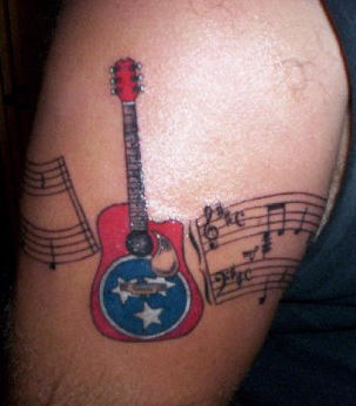 pics of music note tattoos. musical notes tattoo.