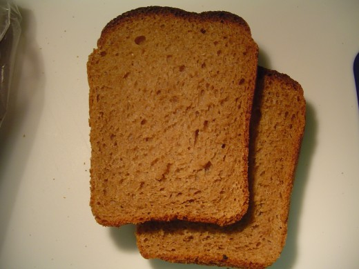 Close up on the orlowsky bread slices. This is a rye bread characterized by its darker color. No coarse flour is visible