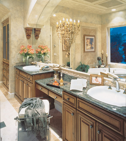 Traditional medium wood raised wood panel cabinets with lowered vanity between two porcelain sinks