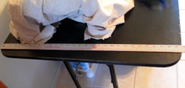 Measure the width of the table top, the length of the table top. For a three sided table skirt like the one in this project, add the width X 2, plus the length. This will give you the width of the table skirt.