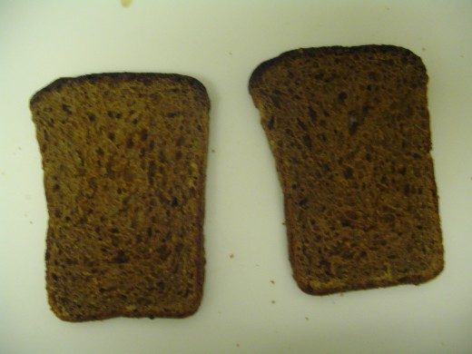 Get 2 slices of rye bread, each 1/2 inch thick. Rye bread holds together well when fried. Lightly toast if desired. 130 calories each