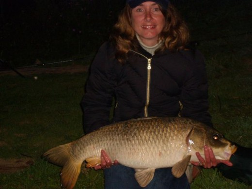 "Me with my Personal Best, ""Neal"" a Ghost Carp 30 lb. I have caught 'Neal' at several weights from 23 lb up to 30 lb."