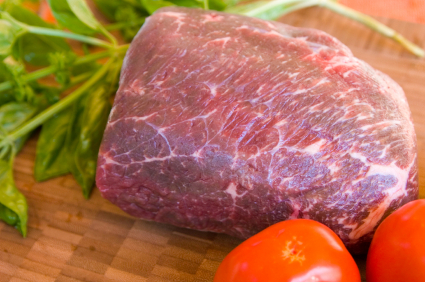 Lean piece of bison rump ready to be grilled or roasted. Photo:  alphavisions@istockphoto