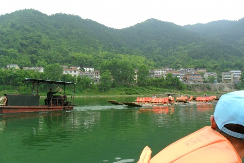 Bamboo boats returning to base
