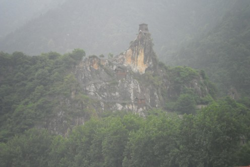 Temple on the top of a stone outcrop.  Note the stairs up the side of the mountain.